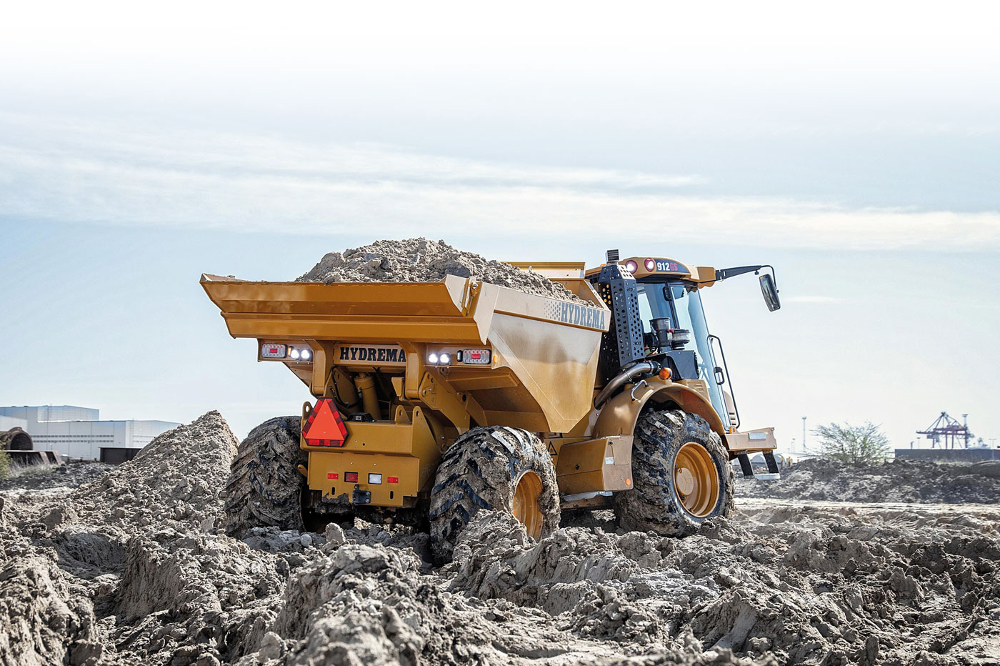 Hydrema 912GS compact dump truck moving material in muddy area